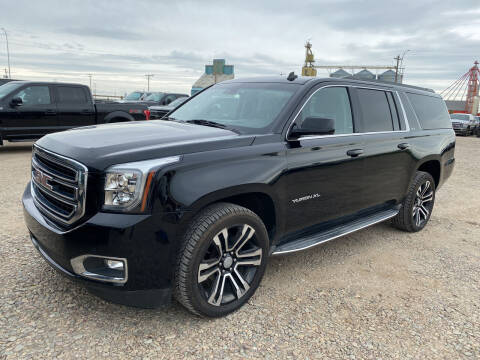 2015 GMC Yukon XL for sale at Truck Buyers in Magrath AB