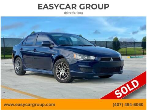 2014 Mitsubishi Lancer for sale at EASYCAR GROUP in Orlando FL