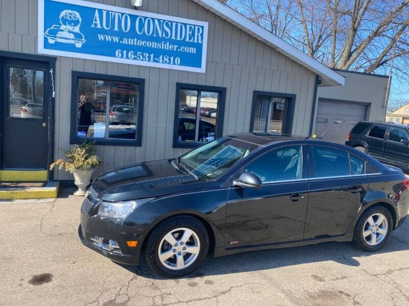 2014 Chevrolet Cruze for sale at Auto Consider Inc. in Grand Rapids MI