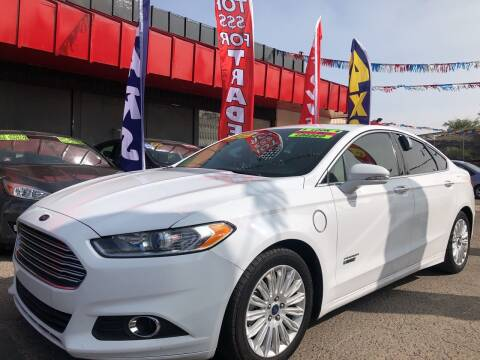 2016 Ford Fusion Energi for sale at Duke City Auto LLC in Gallup NM