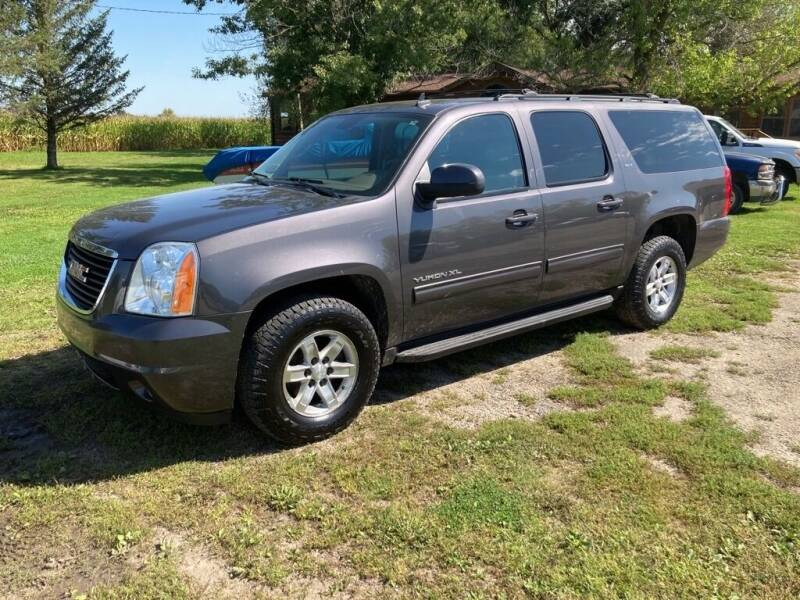 2010 GMC Yukon XL for sale at COUNTRYSIDE AUTO INC in Austin MN