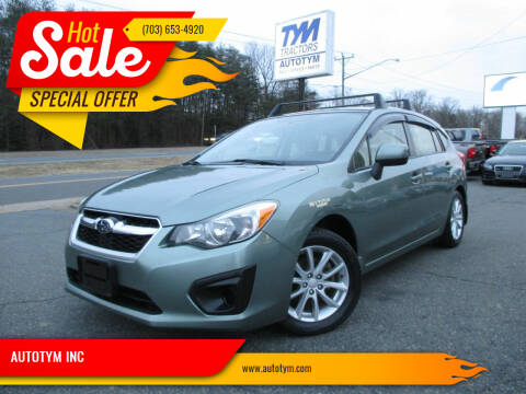 2014 Subaru Impreza for sale at AUTOTYM INC in Fredericksburg VA