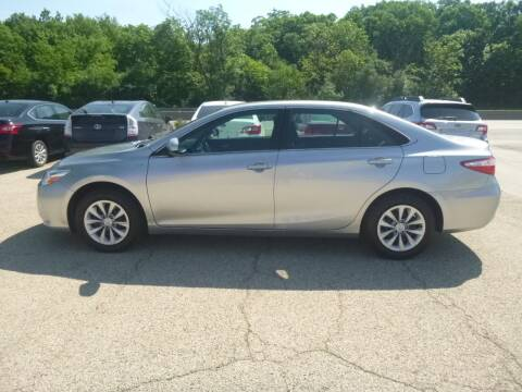 2017 Toyota Camry Hybrid for sale at NEW RIDE INC in Evanston IL