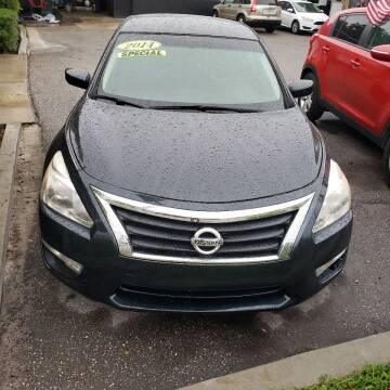 2014 Nissan Altima for sale at HCC AUTO SALES INC in Sarasota FL