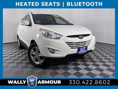 2013 Hyundai Tucson for sale at Wally Armour Chrysler Dodge Jeep Ram in Alliance OH