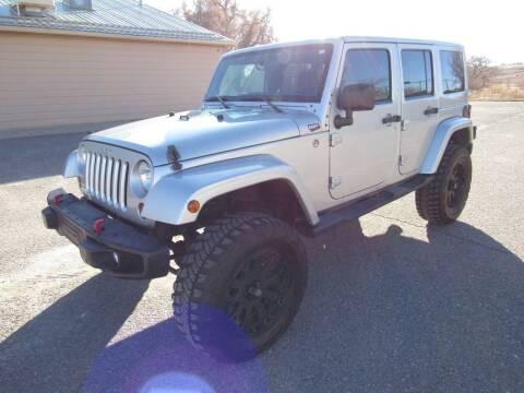 2012 Jeep Wrangler Unlimited for sale at HOO MOTORS in Kiowa CO