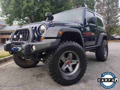 2013 Jeep Wrangler for sale at Carma Auto Group in Duluth GA