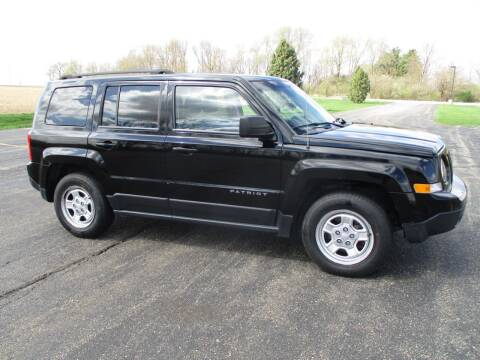 2015 Jeep Patriot for sale at Crossroads Used Cars Inc. in Tremont IL