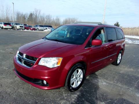 2014 Dodge Caravan for sale at DAVE KNAPP USED CARS in Lapeer MI