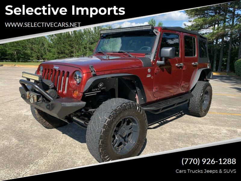 2009 Jeep Wrangler Unlimited for sale at Selective Imports in Woodstock GA