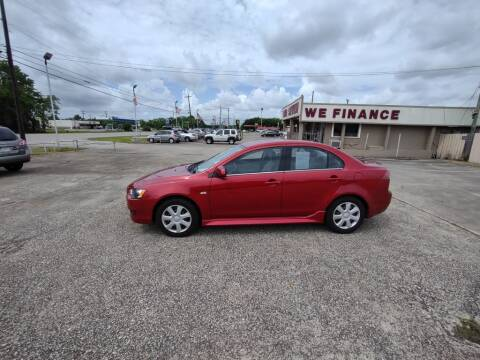 2013 Mitsubishi Lancer for sale at BIG 7 USED CARS INC in League City TX