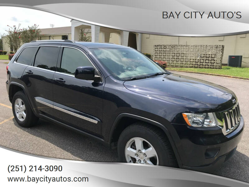 2011 Jeep Grand Cherokee for sale at Bay City Auto's in Mobile AL