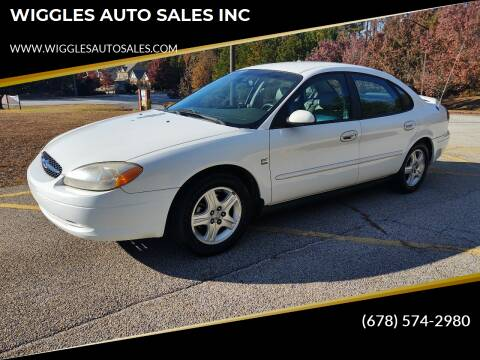 2002 Ford Taurus for sale at WIGGLES AUTO SALES INC in Mableton GA