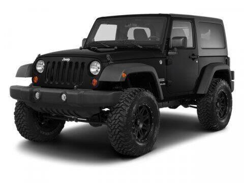 2013 Jeep Wrangler for sale at HILAND TOYOTA in Moline IL