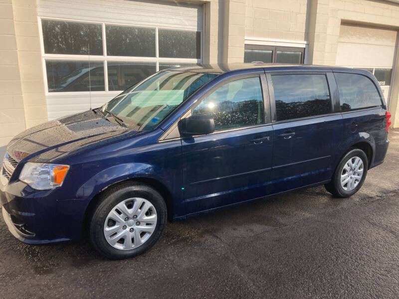 2014 Dodge Grand Caravan for sale at Ogden Auto Sales LLC in Spencerport NY