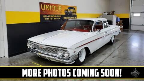 1961 Chevrolet Bel Air for sale at UNIQUE SPECIALTY & CLASSICS in Mankato MN