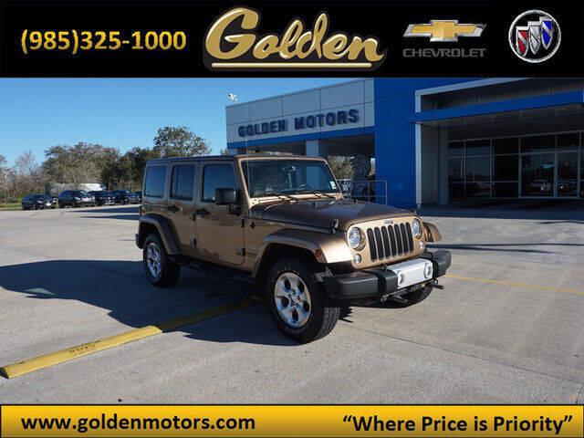 2015 Jeep Wrangler Unlimited for sale at GOLDEN MOTORS in Cut Off LA