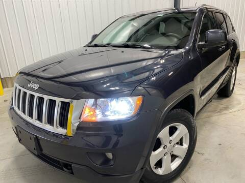 2013 Jeep Grand Cherokee for sale at EUROPEAN AUTOHAUS, LLC in Holland MI