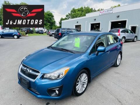 2014 Subaru Impreza for sale at J & J MOTORS in New Milford CT
