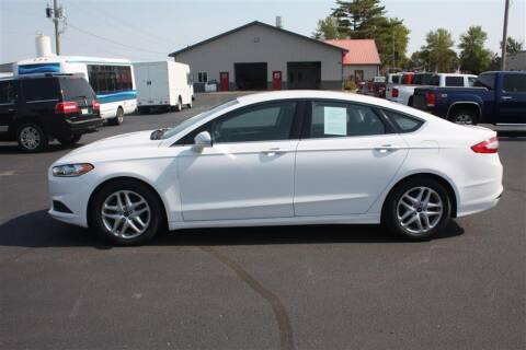 2015 Ford Fusion for sale at SCHMITZ MOTOR CO INC in Perham MN