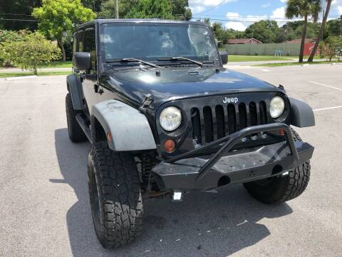 2009 Jeep Wrangler Unlimited for sale at Consumer Auto Credit in Tampa FL