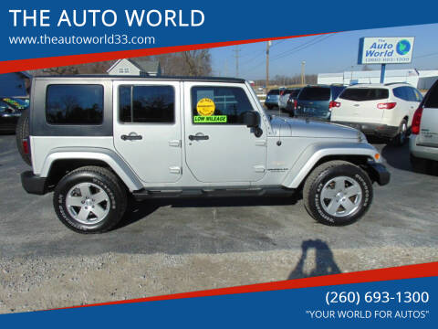 2010 Jeep Wrangler Unlimited for sale at THE AUTO WORLD in Churubusco IN