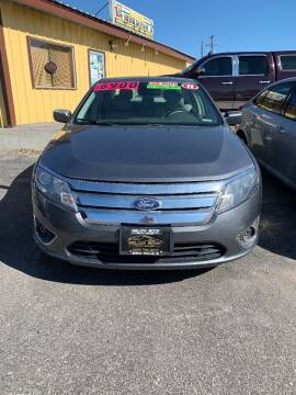 2011 Ford Fusion for sale at BELOW BOOK AUTO SALES in Idaho Falls ID