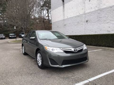 2014 Toyota Camry for sale at Select Auto in Smithtown NY