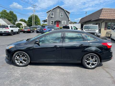 2014 Ford Focus for sale at MAGNUM MOTORS in Reedsville PA