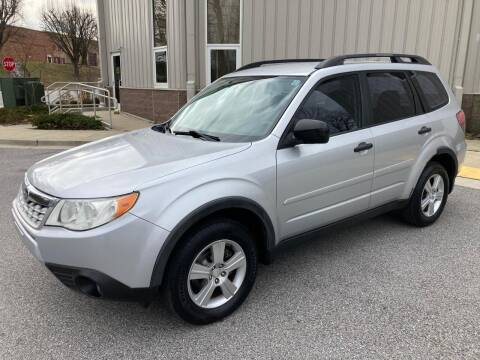 2011 Subaru Forester for sale at AMERICAR INC in Laurel MD