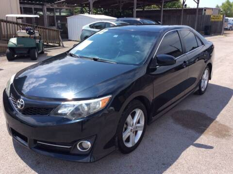2014 Toyota Camry for sale at OASIS PARK & SELL in Spring TX