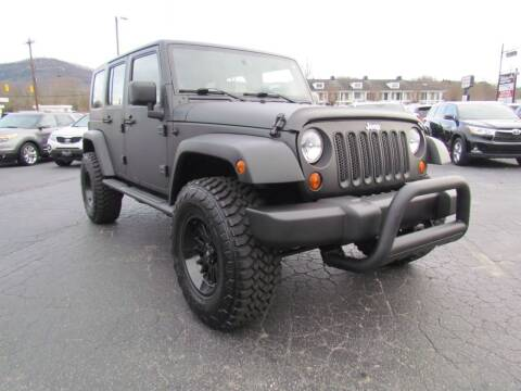 2009 Jeep Wrangler Unlimited for sale at Hibriten Auto Mart in Lenoir NC