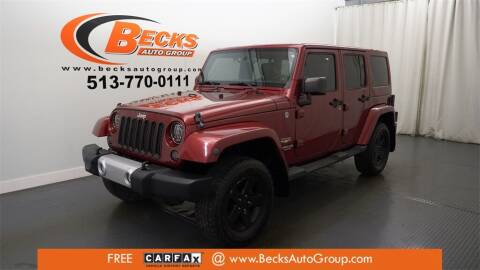 2012 Jeep Wrangler Unlimited for sale at Becks Auto Group in Mason OH