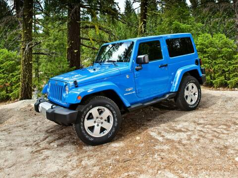2012 Jeep Wrangler for sale at CHEVROLET OF SMITHTOWN in Saint James NY