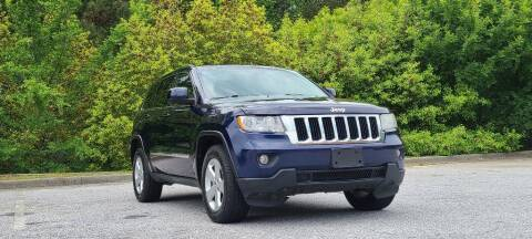 2012 Jeep Grand Cherokee for sale at CU Carfinders in Norcross GA