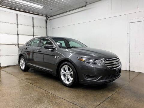 2016 Ford Taurus for sale at PARKWAY AUTO in Hudsonville MI