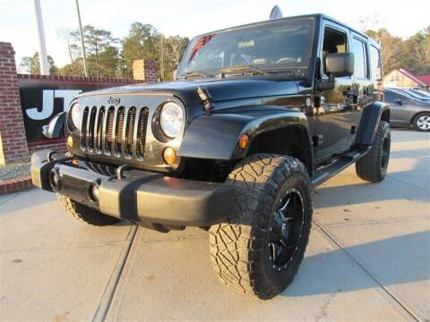 2012 Jeep Wrangler Unlimited for sale at J T Auto Group in Sanford NC