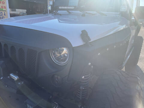 2013 Jeep Wrangler Unlimited for sale at Best Buy Auto Sales in Hesperia CA