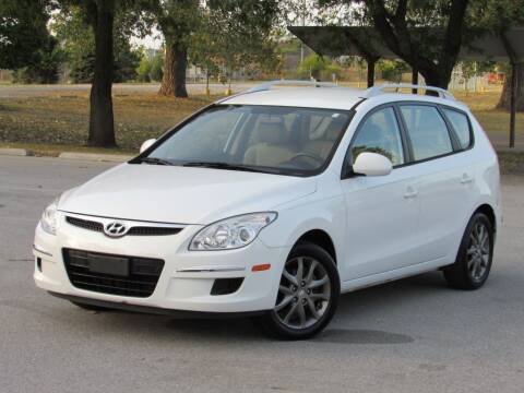 2012 Hyundai Elantra Touring for sale at Highland Luxury in Highland IN