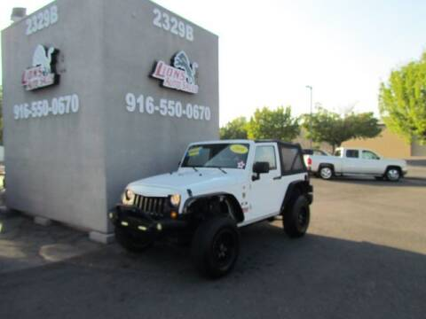 2009 Jeep Wrangler for sale at LIONS AUTO SALES in Sacramento CA