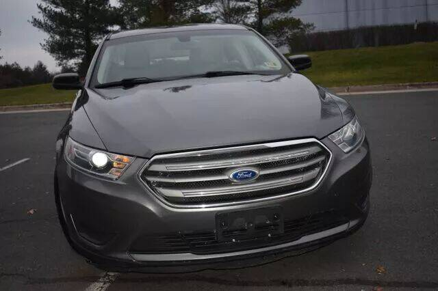 2014 Ford Taurus for sale at SEIZED LUXURY VEHICLES LLC in Sterling VA