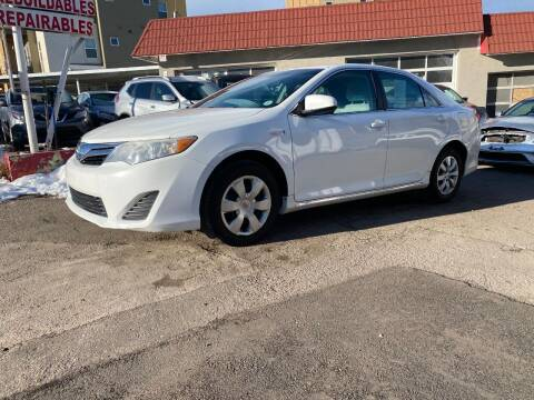 2012 Toyota Camry Hybrid for sale at STS Automotive in Denver CO