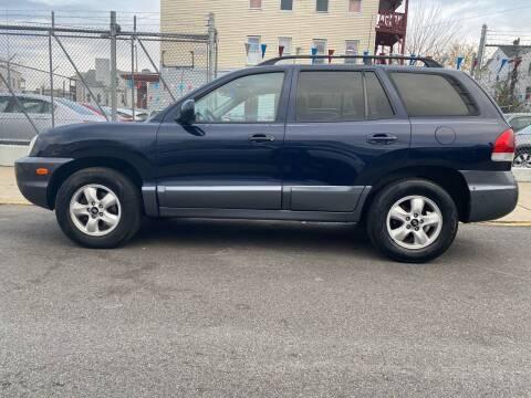 2005 Hyundai Santa Fe for sale at G1 Auto Sales in Paterson NJ