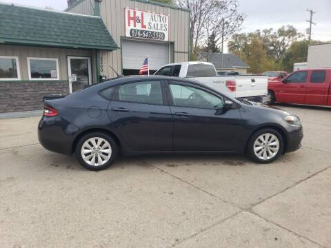 2014 Dodge Dart for sale at H & L AUTO SALES LLC in Wyoming MI