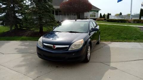 2009 Saturn Aura for sale at Heartbeat Used Cars & Trucks in Harrison Twp MI