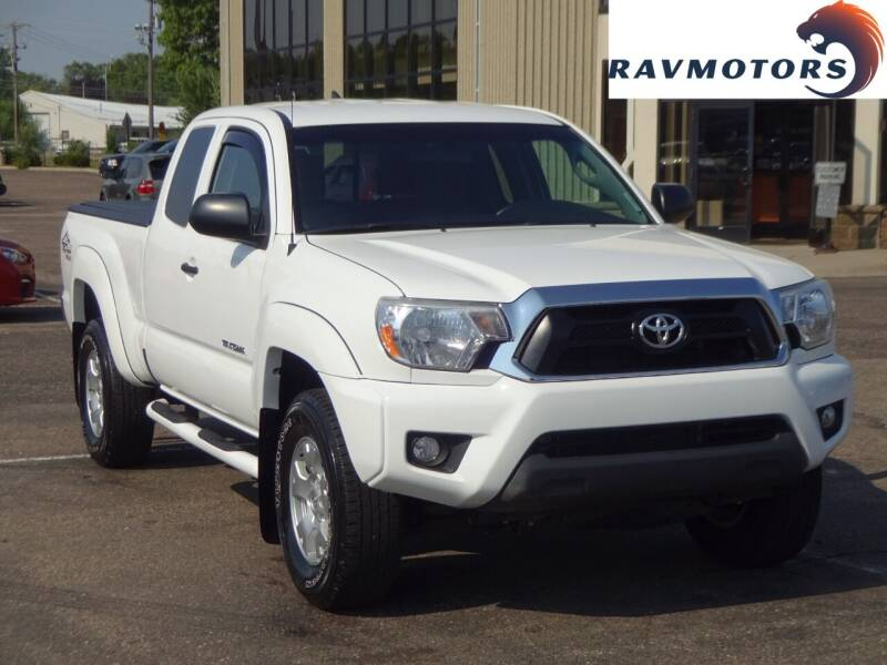 2015 Toyota Tacoma for sale at RAVMOTORS 2 in Crystal MN