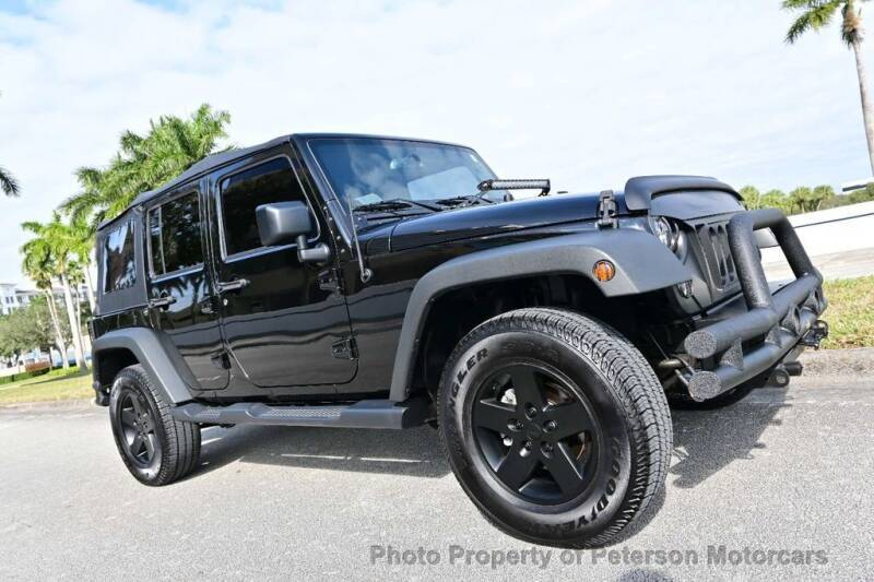 2017 Jeep Wrangler Unlimited for sale at MOTORCARS in West Palm Beach FL
