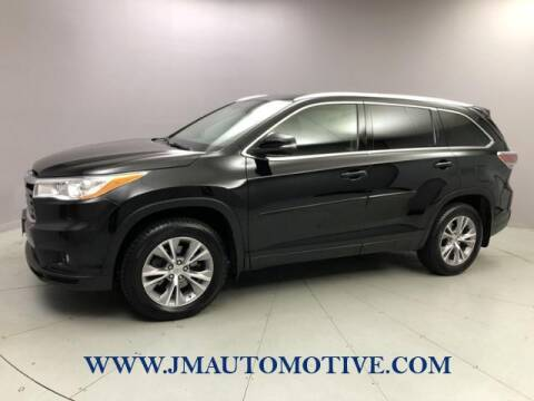 2014 Toyota Highlander for sale at J & M Automotive in Naugatuck CT