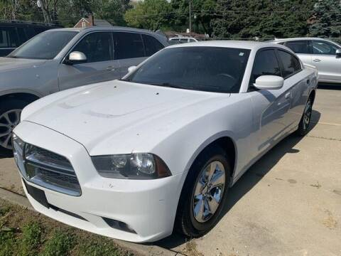 2012 Dodge Charger for sale at Martell Auto Sales Inc in Warren MI
