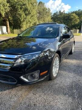2012 Ford Fusion Hybrid for sale at Royal Auto Mart in Tampa FL